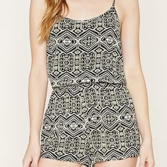 Aztec Print Black and Taupe Halter Jumpsuit Similar to the cover photo. The back is a low back. Ties at the neck and in the middle of the back as you can see the ties in the photo. Size Large! Still has tags on it. Never worn. Bought from forever 21. Forever 21 Dresses