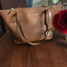Micheal kors east west purse saguaro leather Cognac color has minor stains as pictures doesn't affect at all zipper is fully functional liner is unsewun side pocket Michael Kors Bags Shoulder Bags