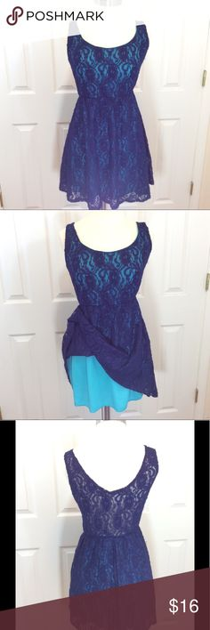 Delias blue lace with turquoise lining dress M Delias blue lace with turquoise lining dress juniors medium. The dress is lined except for the back please look at pictures three. Measurements taken from the back with the garment laying flat bust 28 inches and has an length of 31 inches, all measurements are approximate. Dress is made of 100% nylon. Summer, cruise wear, spring break Delias Dresses