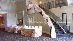 Pink Staircase Decor - Woodbridge Wedding Decorations - Custom Backdrop Design and Head Table Draping Design by Mapleleaf Decorations in colour satin and sheer fabrics. Contact us for more info www.MapleleafDecorations.com
