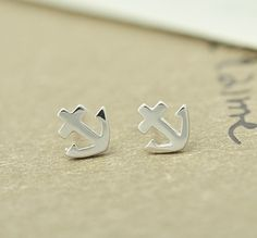 $12.99   Silver simple anchor earrings                                 small and delicate minimalist silver anchor earrings I hope you'll like it