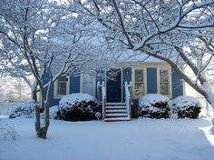 Snow on the Blue Cottage by Tony Crider, via Flickr