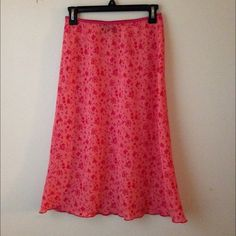 Floral printed skirt - excellent condition, elastic waist, below knee length, sheer, wavy hem detailing, 100 % polyester, machine wash cold, soft fabric, size runs small, will fit small, has redish-pink tone, no filter is used, camera flash was used, perfect spring/summer wear X-trordinary Skirts