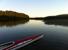 Kayaking at the beautiful river Klarälven. A 20km tour from Forshaga to Karlstad with magical sunset, 20 degrees in the water and the full moon rising over the horizon.