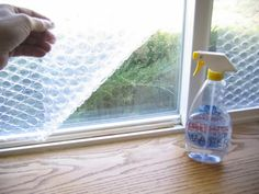 Take it one step further with DIY bubble wrap insulation. All you need is some leftover sheets of bubble wrap, an Exacto knife, and a spray bottle full of water, and you could reduce window heat loss by 50%.