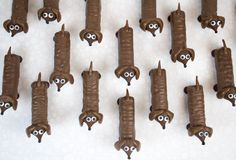 Whoa! How to make these chocolate dogs with leftover Halloween candy via @followcharlotte