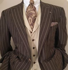 The tobacco brown chalk stripe for town. Here in a crisp, light 8.5 oz plain weave. With an air of formality similar to navy or charcoal, and flattering to all skin types, the brown suit for day has a place in every professional wardrobe. Here, paired with a silk Dupioni waistcoat and rich, woven paisley tie. #woveninhuddersfield #artisanaltailoring #handmadetie #menscouture #mensfashion #luxurylifestyle #maleelegance #savoirvivre #igdaily #instafashion #instaphoto #ootdshare…