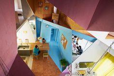 kochi architect's studio renovates tokyo apartment with asymmetric plywood planes