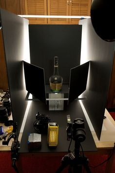 How to Photograph Liquor Bottles Using Dark Field Lighting- could do this with perfume bottles