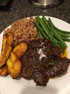 Pork chops,string beans, rice n peas with fried plantains !