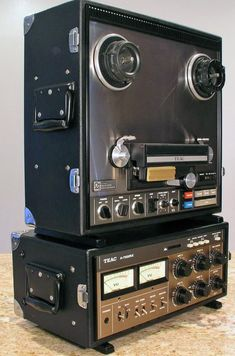 """Teac 1975 A-7300RX 1/4"""" 2 track reel to reel recorder in portable field cases."""
