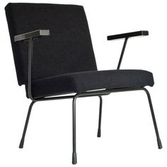 1950s Dutch Industrial 1401 Chair by Wim Rietveld for Gispen, New Upholstered | From a unique collection of antique and modern lounge chairs at https://www.1stdibs.com/furniture/seating/lounge-chairs/