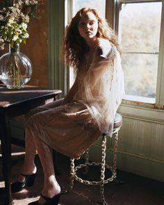 I love this unique antique picture of lily cole and the vase with the flowers in the background is so lovely