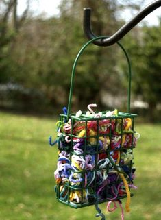get rid of all those small scraps of yarn and string from your previous projects. Just use a basic suet feeder and shove everything inside so wildlife can come take what they need for nests.