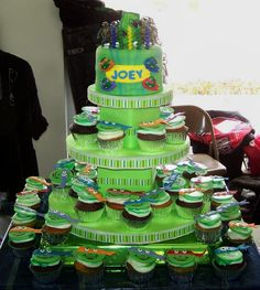 """Teenage Mutanat Ninja Turtles cupcake tower - This was for my son's 5th birthday.  We had the party at a karate studio, hence the ninja turtle theme.  There are 40 cupcakes and a 6"""" cake tooper.  1/2 were chocolate cupcakes with vanilla frosting, the other 1/2 were banana cupcakes with caramel filling and cream cheese frosting.  Cake is chocolate chip.  TFL"""