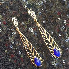 Kendra Scott Earrings Stunning gold tone wire earrings with blue stone. So unique! Kendra Scott Jewelry Earrings