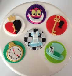 Mad Hatter and Alice In Wonderland Inspired Fondant Cupcake Toppers. $24.00, via Etsy.