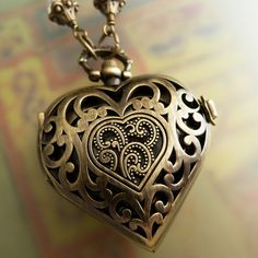 heart locket with watch.....very special. A time for Love.