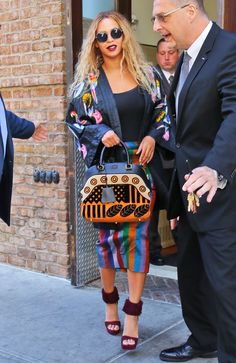 Printed kimono jacket? Check. Printed skirt? Check. Printed statement bag? Check. Fluffy heels? Check. This is a winning fashion combo from Beyoncé, but we expected no less TBH.