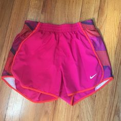 Nike dri-fit shorts Pink Nike Dri-fit shorts. In great condition, worn only a handful of times. No stains, tears, or rips. The inner lining is in tact. Fits small and extra small. Nike Shorts