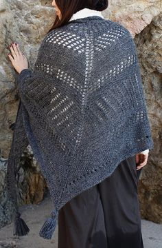 Free Knitting Pattern for Cambria Wrap - Oversized triangle shawl with alternating stockinette, garter, and eyelet texture stripes. Worsted weight yarn. Designed by Alexandra Tavel