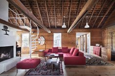 Christoff : Finio Architects Taryn Christoff and Martin Finio of Christoff : Finio Architecture designed this space, which features a spiral staircase that leads up to a loft area, which was left open to the rafters.