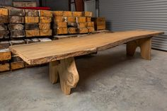 Cypress slab table with live edge and 2.5″ thick top and leg construction.