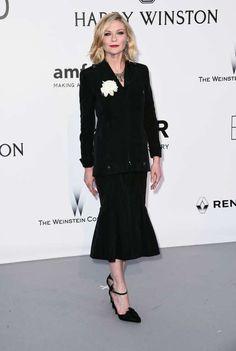 Kirsten Durst apostou em um vestido midi Chanel, sapatos Christian Lacroix Haute Couture e joias Fre... - Getty Images