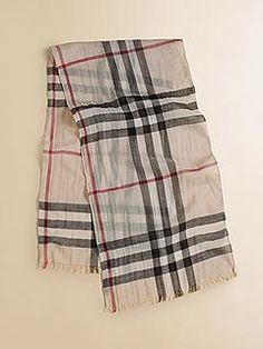 Splurge: From its classic checked pattern to its subtle fringe, Burberry's Kids Gauze Check Scarf ($130) is a timeless accessory that will never go out of style.