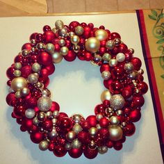 Red and gold Christmas ball wreath  I am planning to make a Christmas wreath because I cannot find one I absolutely love. I am getting inspiration! :)