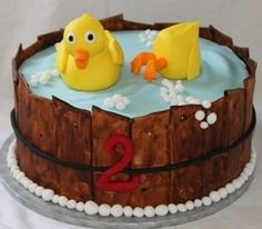 Rubber ducky birthday cake - cute - could use kit-kats for the bucket, then blue icing and buy a yellow duck