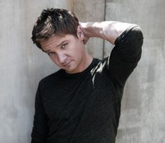 Jeremy Renner --- i think that's who he reminds me of...cept my guy's eyes are sooooo blue that I drown in them