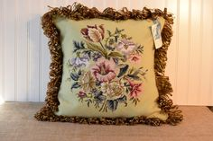 Needlepoint/petit point pillow with contemporary trim by NestingInstinctShop@etsy.com, $80.00 Vintage needlepoint repurposed into large pillow.  Button closure on velveteen backing.