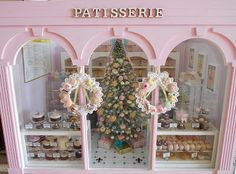 Pink Patisserie. (This little patisserie has been prettily decorated well in time for Christmas. The cakes look good but the tree is full of sweet goodies too.. click through for more pics)