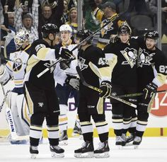 The Penguins' celebrate Conor Sheary's goal against the Sabres in the second period Tuesday, March 29, 2016 at Consol Energy Center.