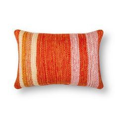 The Threshold Striped Lumbar Pillow in Orange Multi is as cheerful as the warm glow of the sun. This rectangular throw pillow has a variety of stripes and orange tones to create visual interest.