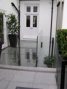 IQ Glass design and install near frameless structural glass bridges across almost any span, internally or externally. Walking On Glass, Glass Bridge, Pergola Canopy, Glass Floor, Patio, House Extensions, Flat Roof, Pergola Plans, Glass Design