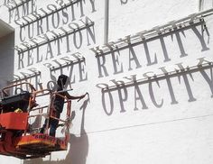 A typographic shadow graffiti that changes during the day - Designer Daily: graphic and web design blog