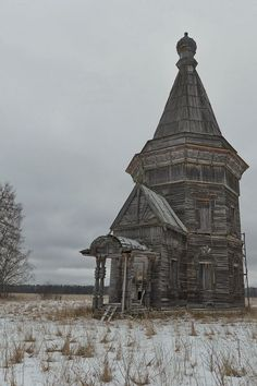 Old church standing on the plain of Kargapol, Russia, open to wind and weather. Dated 1655, the church is one of the oldest architectural monuments of the Arkhangelsk region near the village of Saunino.