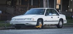 Chevrolet Lumina with parking clamp