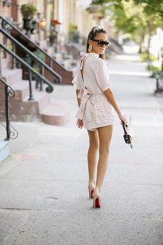 Get this look: http://lb.nu/look/8751143  More looks by Lauren Recchia: http://lb.nu/laurenrecchia  Items in this look:  Urban Outfitters Bow Tie Back Top, Urban Outfitters Ruffle Shorts, Christian Louboutin Pumps   #chic #classic #vintage #ootd #outfit #outfitpost #pink #blush #ruffles