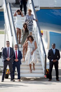 Pin for Later: Michelle Obama Touches Down in Spain With Her Daughters and Mother