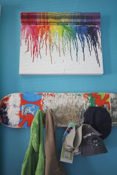 Two fun things...the crayola wall art, and the skateboard with hooks for hanging stuff.