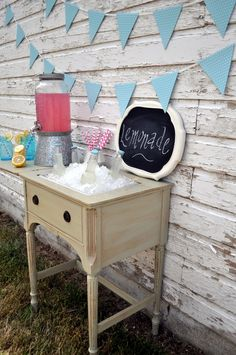 Ice Cubes in my Nightstand!? An old Sewing Machine table used for a drink station but also a night stand. Cute!