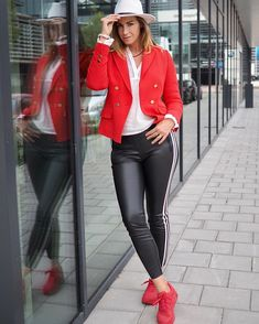 Red paired with black and white | Photo shared by Claudia Kooij | For more style inspiration visit 40plusstyle.com