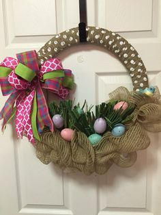 Cute Idea to use a round wreath form and deco mesh to make an Easter Basket with robin eggs and a blue bird