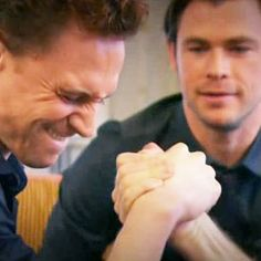 Arm wrestling with Chris Hemsworth. Bad idea Tom you might break your arm.