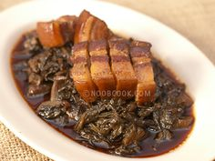 Steamed Mui Choy (Mustard Greens) with Pork/Mei Cai Kou Rou (梅菜扣肉) This is a Hakka delight and although quite tedious to prepare the traditional way, it is not difficult. The tedious part comes from prepping the mustard greens (mui choy/mei cai) to thoroughly get rid of fine sand particles.