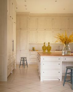An understated kitchen with lots of storage, all behind solid panel doors.   Mary Douglas Drysdale