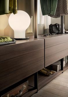 The Hangar walk-in closet designed by Piero Lissoni aims to create a personal space that is visually appealing and comfortable, Cupboard Wardrobe, Closet Drawers, Wardrobe Closet, Walk In Closet, Dressing Room Design, Dressing Rooms, Walk In Wardrobe Design, Wardrobe Lighting, Home Collections